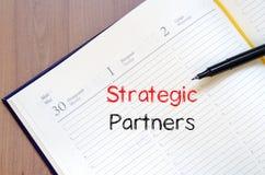 Strategic partners write on notebook. Strategic partners text concept write on notebook Stock Images