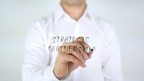 Strategic Partnership, Man Writing on Glass. High quality royalty free stock photos