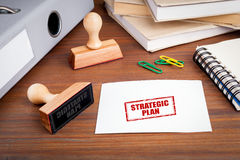 Strategic Plan. Rubber Stamp on desk in the Office Stock Photography