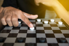 Strategic Planning, Man playing checkers game.  royalty free stock photos