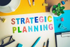 STRATEGIC PLANNING word on desk office background with supplies. Colorful of business working table.marketing concepts Royalty Free Stock Photos