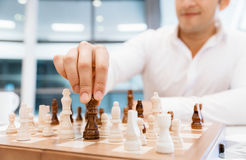 Strategic play. Two businessmen with chess in office Stock Photography