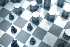 Strategic positions and movements on a blue chessboard Stock Image