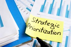 Strategic Prioritization. Documents and folder with papers royalty free stock images