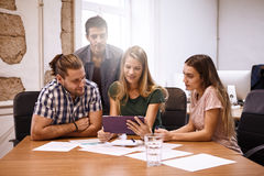 Strategic team of professionals in meeting Stock Image