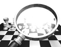 Strategies concept with magnifying glass and chess pieces Royalty Free Stock Images
