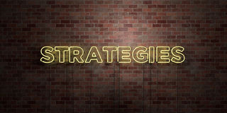 STRATEGIES - fluorescent Neon tube Sign on brickwork - Front view - 3D rendered royalty free stock picture Stock Photo