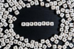 Strategiewort gemacht von den Spielzeugwürfeln lizenzfreies stockfoto