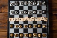 Strategiskt begrepp för schackbräde och för planläggning för affär för ` för plan för text` royaltyfri fotografi