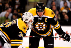 Strategy. Bruins captain Zdeno Chara (33) and goalie Tim Thomas (30) discuss defensive strategy Royalty Free Stock Photo