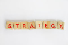 Strategy. A eight letter word - strategy in scrabble word game Royalty Free Stock Images
