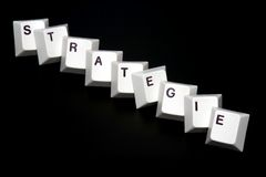 Strategy. Single keys with the word strategy Stock Images