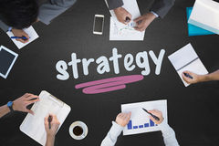Strategy against blackboard. The word strategy and business meeting against blackboard royalty free stock images