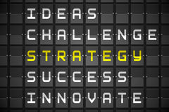 Strategy buzzwords on black mechanical board Royalty Free Stock Photos