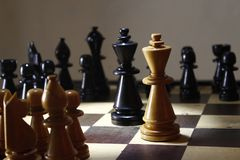 Strategy chess game, the king fight on board stock photos