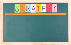Strategy, colorful word on blank blackboard Stock Photos
