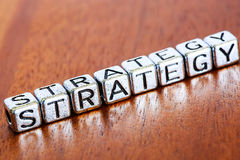Strategy concept business marketing letters placed on a desk in Stock Images