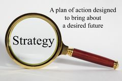 Strategy Concept and Magnifying Glass stock image