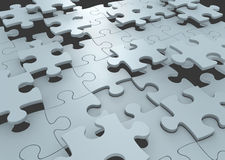 Strategy concept of puzzle pieces connecting to form a solution to a challenge. Jigsaw puzzle pieces falling into place to complete the game Stock Image