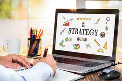 Strategy Concept With Various Hand Drawn Doodle Icons On Laptop stock photography