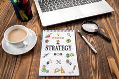 Strategy Concept With Various Hand Drawn Doodle Icons On Paper Royalty Free Stock Photography