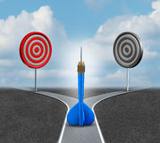 Strategy Decision. Business concept as a confused blue dart deciding which bull eye target to aim for as a metaphor for strategic advice and consulting stock illustration
