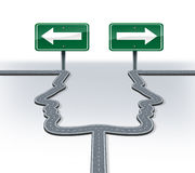 Strategy decisions. And career choices at a cross roads with a fork in the road shaped as two human heads in a concept of a business dilemma choosing the Royalty Free Stock Photos