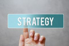 Strategy - finger pressing blue transparent button royalty free stock photography
