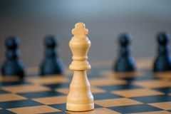 Wooden Chess Board and Chess Pieces stock image