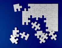 Strategy game white puzzle on blue background business team concept 3D illustration Royalty Free Stock Images