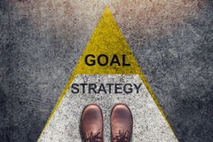 Strategy and Goal concept, Shoes stand over Triangle level Shape. Top view and Dark tone, Grunge Dirty Concrete Floor as Background Stock Photography