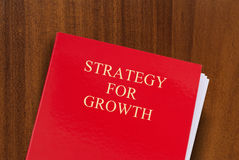 Strategy for growth. Red folder on desk with title Strategy for Growth. Shot from above Stock Photo