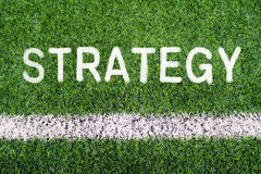STRATEGY hand writing text on soccer field grass Stock Photo