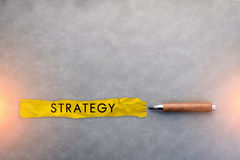 strategy ideas concept with yellow wrinkle paper Stock Photos