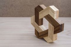 Puzzle composed of pieces of a star. Strategy and intelligence games made through pieces of wood that come together to make sculptures royalty free stock photography