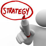 Strategy - Leader Writes Plan on Board to Lead Team to Success. A person draws the word Strategy and a circle around it using a red marker, plotting and planning Stock Photos