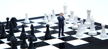 Strategy. Lone businessman thinkign about the right strategy Stock Images
