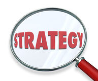 Strategy Magnifying Glass Evaluate Assess Examine Plan Mission O. Strategy word under magnifying glass to illustrate evaluating, assessing or examining the Royalty Free Stock Photography