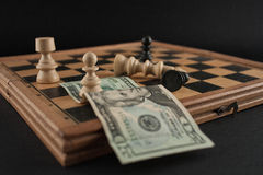Chess table with dollar bill  Stock Photo