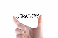 Strategy. Note between two fingers Royalty Free Stock Image