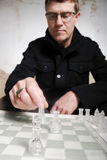 Strategy and Planning. Concept for strategic planning showing a chess player making a move Stock Image
