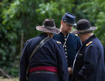 Strategy Planning. Civil War era soldiers planning their strategy battle at the Dog Island reenactment in Red Bluff, California stock photos