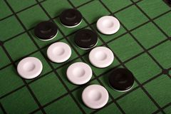Strategy Required!. Close up of the board game Othello. Pieces displayed near the beginning of play Royalty Free Stock Photo
