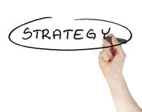 Strategy sign written by a felt tip pen on a glass isolated Royalty Free Stock Photos