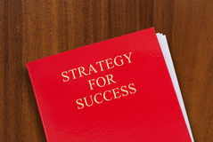 Strategy for success. Red folder on desk with title Strategy for Success. Shot from above Royalty Free Stock Image