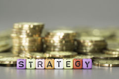 Strategy text and gold coins Stock Image