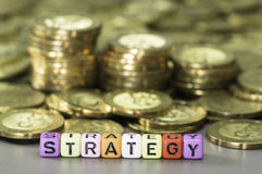 Strategy text and gold coins Royalty Free Stock Photography