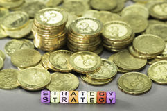 Strategy text and Gold coins Stock Images