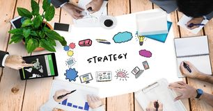 Strategy text by signs and hands of business people Stock Photo