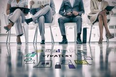 Composite image of strategy text surrounded by various icons. Strategy text surrounded by various icons against group of well dressed business people waiting Royalty Free Stock Photos
